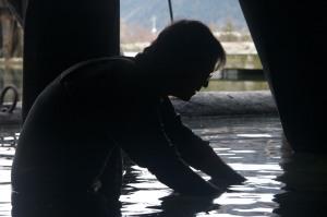 Scott filming juvenile fish under a dock. Photo by: Ed Thwaites.